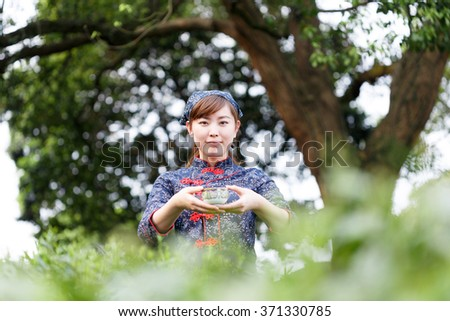 asian pretty tea-picking girl in plantation