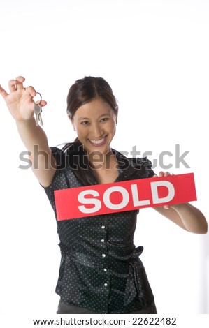 Asian real estate agent home buyer holding a set of house keys