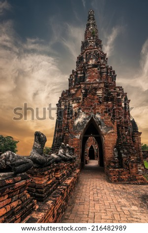 Asian religious architecture. Ancient Buddhist pagoda ruins at Chai Watthanaram temple under sunset sky. Ayutthaya, Thailand travel landscape and destinations - stock photo