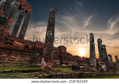 Asian religious architecture. Ancient Buddhist pagoda ruins at Wat Phra Sri Sanphet temple under sunset sky. Ayutthaya, Thailand travel landscape and destinations - stock photo