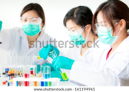 asian Researcher working with chemicals - stock photo