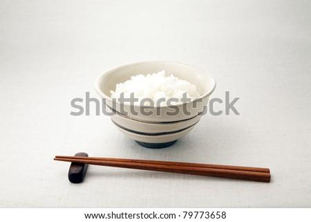 asian rice bowl and chopstick. - stock photo