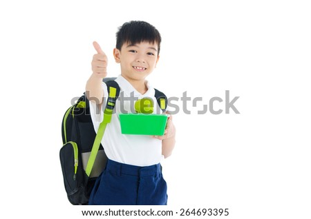 Asian schoolboy holding food container and apple. Healthy eating for school kid concept. - stock photo