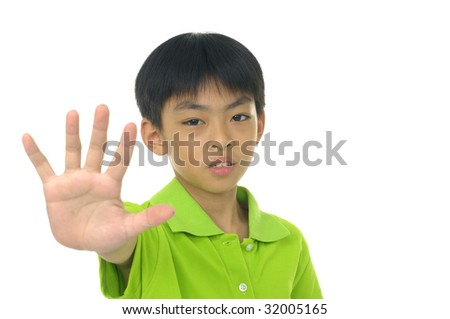 Asian schoolboy in uniform making Stop sign with his hand - stock photo