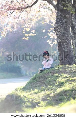 asian schoolgirl with nature - stock photo