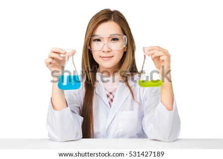 Asian scientist with liquid solution in a lab