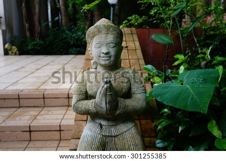 Asian sculpture in greeting action