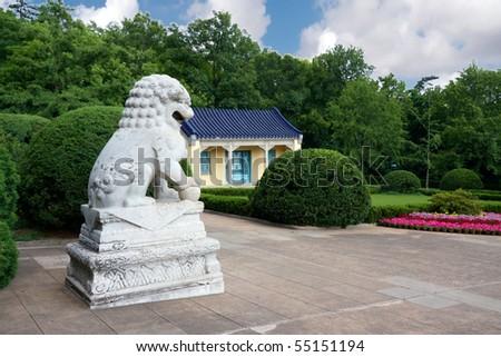 Asian sculpture near a building - stock photo
