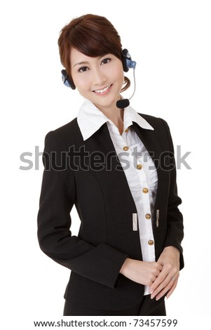 Asian secretary woman with headphone smiling and looking at you, half length closeup portrait on white background.