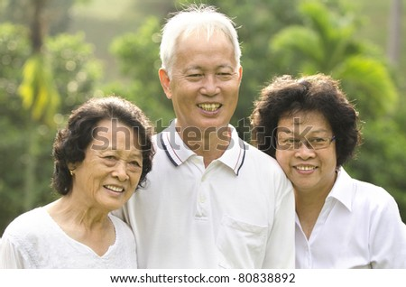 asian senior adult family with outdoor background - stock photo