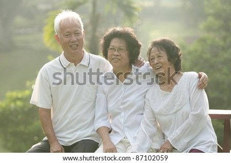 asian senior adult family with outdoor background