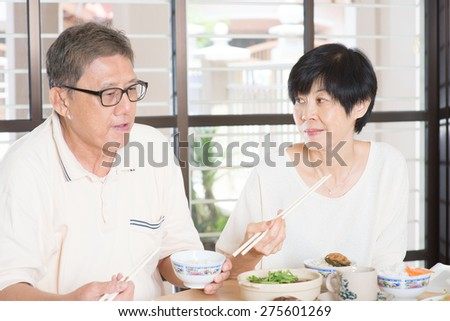 Asian Senior couple having meal at home. Family living lifestyle.