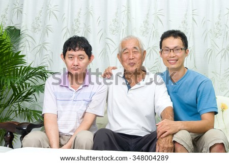 Asian senior father with his adult sons at home. Family living lifestyle. - stock photo