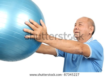 Asian senior man lift a fit ball on white background