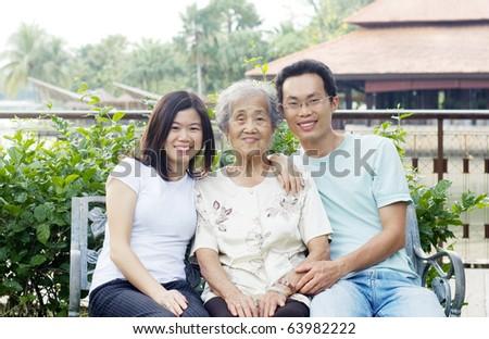 Asian senior woman and grandchildren - stock photo