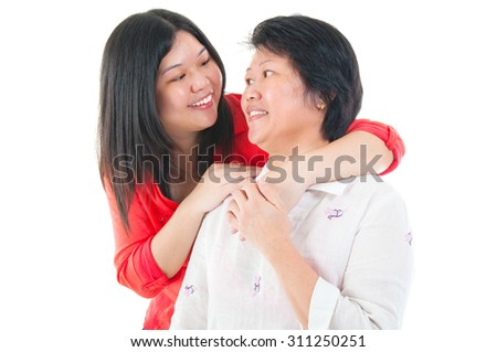 Asian senior woman talking with daughter isolated on white background - stock photo