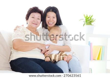 Asian senior woman together with daughter and grandson - stock photo