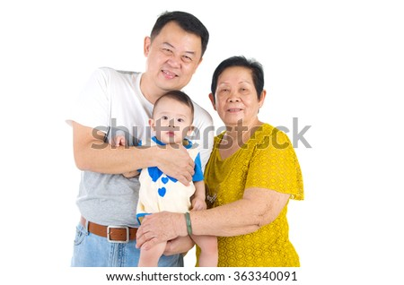 Asian senior woman with her son and grandchild - stock photo