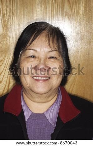 Asian senior woman with ringflash - stock photo