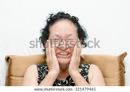 asian senior woman with toothache - stock photo