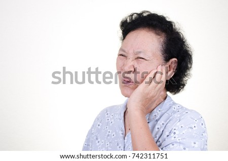 Asian Senior woman with toothache expression over white background