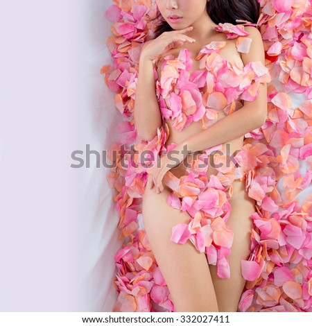 asian sexy Girl in flower spa - stock photo