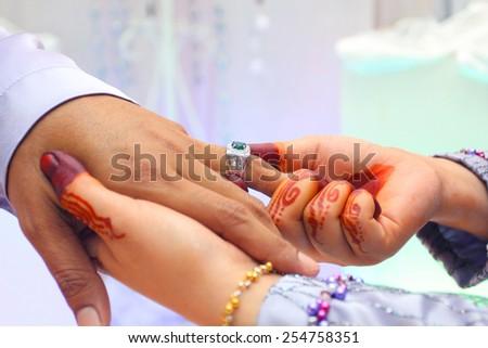 asian sheath wedding ring ceremony - stock photo