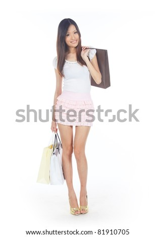 Asian Shopper with Shopping Bags on White