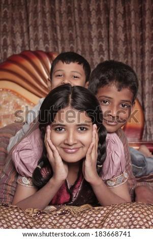 Asian Siblings in the bedroom - stock photo