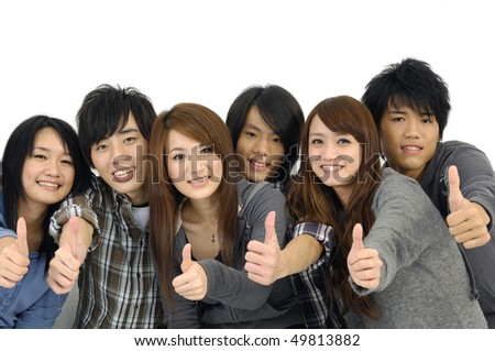 Asian six young teenagers laughing and giving the thumbs-up sign. - stock photo