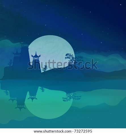 Asian skyline and river at night - stock photo