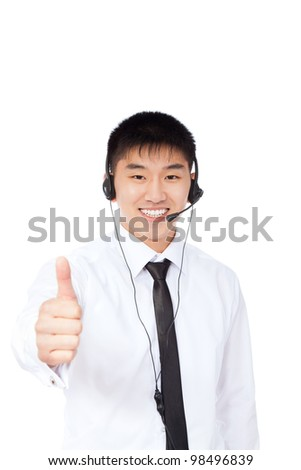 Asian smile businessman of call center office show thumb up gesture, support phone operator with headset isolated over white background, young business man agent friendly looking at camera - stock photo