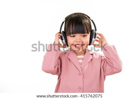 Asian smiling little girl portrait with headphones isolated on white