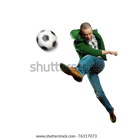 asian soccer player on training, kick the soccer ball - stock photo