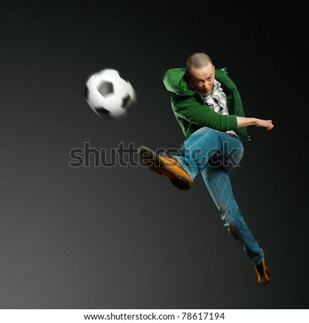 asian soccer player on training, kick the soccer ball