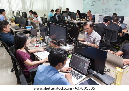 Asian Software Developers Business People Sitting Desk Working Laptop Computer Businesspeople Team Real Office - stock photo