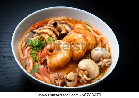 Asian spicy seafood noodle soup - stock photo