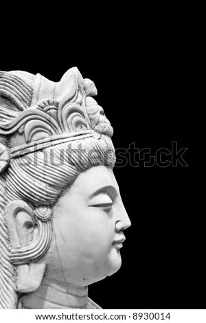 Asian Statue Isolated on Black Background.