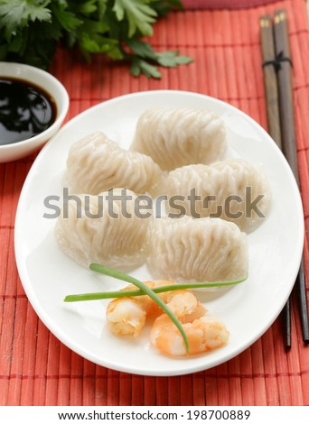 Asian steamed meat dumplings dim sum with soy sauce - stock photo