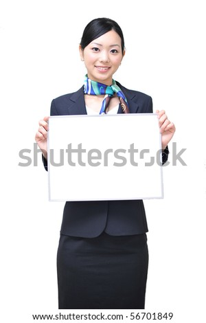asian stewardess holding a white board - stock photo