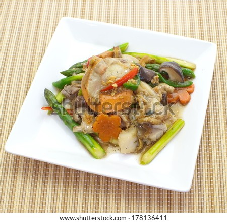 Asian stir fried asparagus cooked with seafood and various vegetable ingredients - stock photo