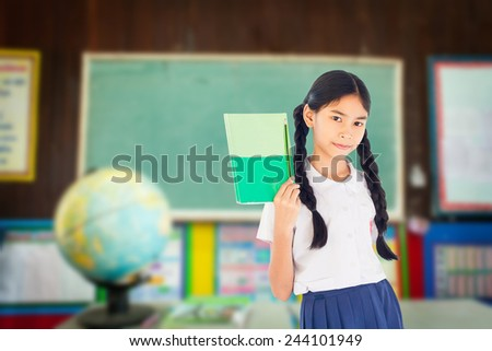 Asian student girl pointing in the classroom