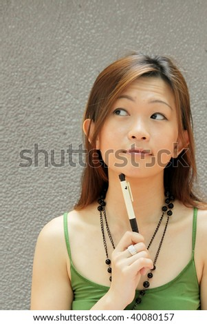 Asian Student Thinking of College Course Choice - stock photo