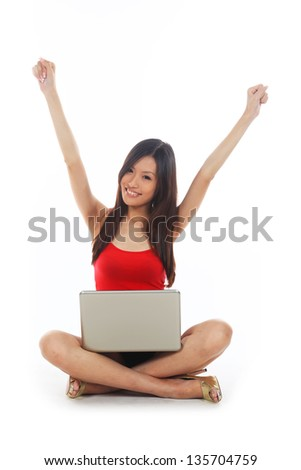 Asian Student Using Computer Notebook and Happy