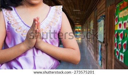 asian student wear uniform Thai gesturing in front of the classroom, Welcome back to school - stock photo