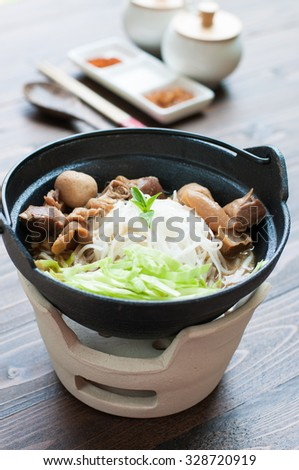Asian style beef noodles in soup - stock photo