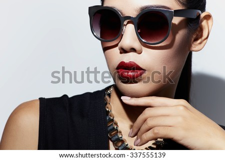 Asian style black hair model with sunglasses close up portrait in the studio - stock photo
