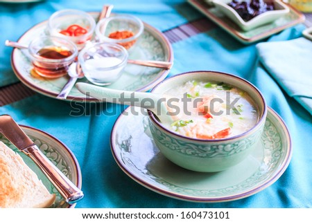 Asian style breakfast soft boiled rice, rice soup Thailand food - stock photo