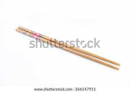 asian style chopstick on white background - stock photo