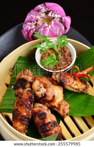 Asian style, hot Meat Dishes - Fried Chicken Wings with Curry Sauce  - stock photo